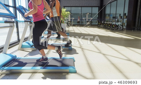 Gym with various exercise machines in it and people walking on treadmill at sunny day. 3D Rendering 46309693