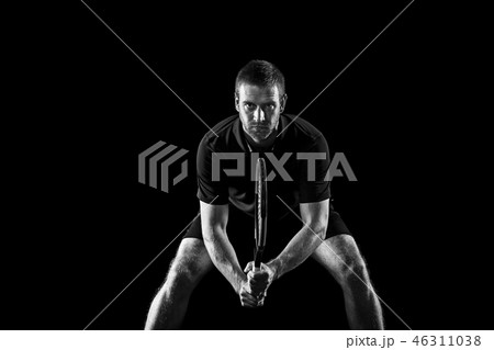 one caucasian man playing tennis player on black background 46311038