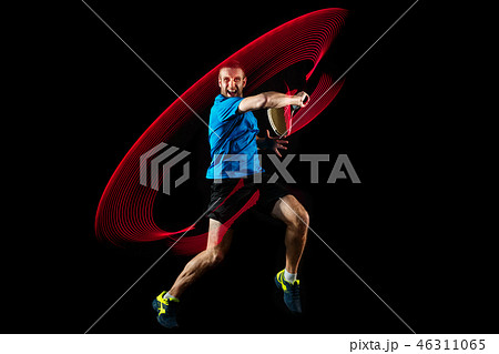one caucasian man playing tennis player on black background 46311065