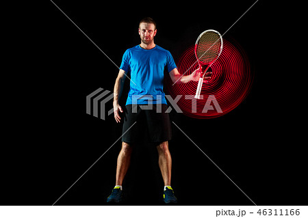 one caucasian man playing tennis player on black background 46311166