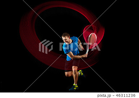 one caucasian man playing tennis player on black background 46311236