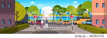 man help senior woman with walking stisk crossing street urban city traffic cars on road crosswalk 46363702