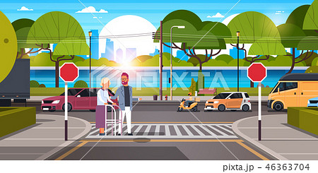 man help senior woman with walking stisk crossing street urban city traffic cars on road crosswalk 46363704