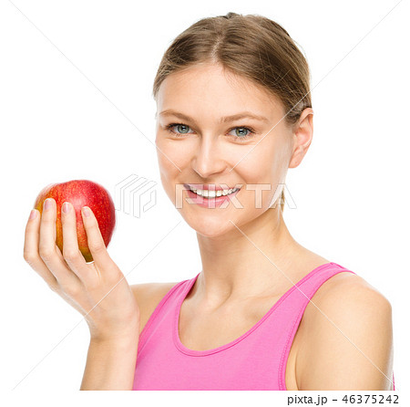 Young happy girl with apple 46375242