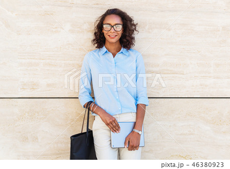 Smiling businesswoman wearing eyeglasses 46380923