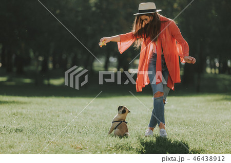 Young woman is training her nice puppy 46438912