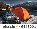 Man playing with his dog outdoors mountain terrain 46446001