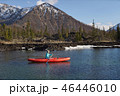 Woman is riding canoe on lake in mountain area in spring time 46446010