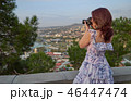 Woman tourist taking photo by camera of the old city 46447474