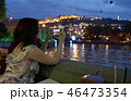 Woman taking picture of a city weekend in outdoor restaurant. 46473354
