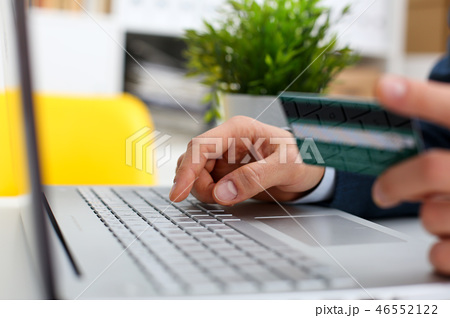 Male arms hold credit card press buttons 46552122