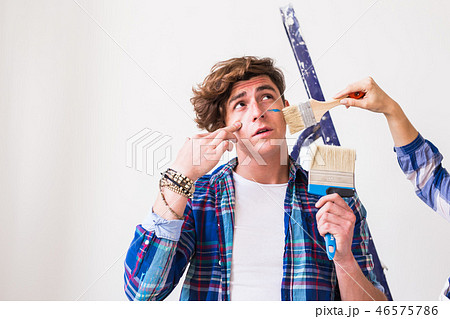 People, redecoration, renovation and repair concept - Portrait of young man with paintbrush over 46575786