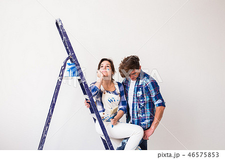 People, renovation and repair concept - Portrait of lovely couple doing redecoration in apartment 46575853