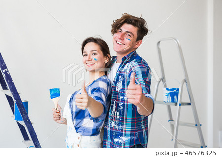 Repair, renovation and people concept - Woman and man gestured thumbs up 46576325
