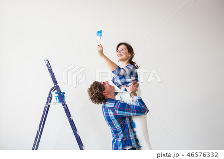 Renovation, repair and relationship concept - Young woman and man hugging each other 46576332