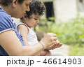 Mother and child in outdoor environment eating  46614903