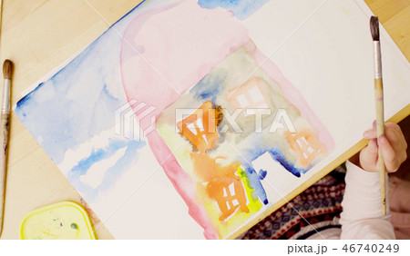 Young artist painting on paper with watercolors 46740249