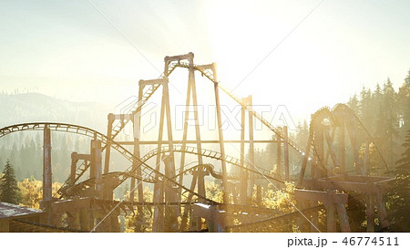 old roller coaster at sunset in forest 46774511