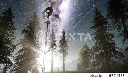 retro windmill in mountain forest with stars 46774523