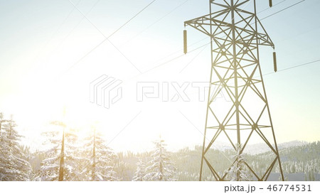electric line at sunrise in snow covered forest 46774531