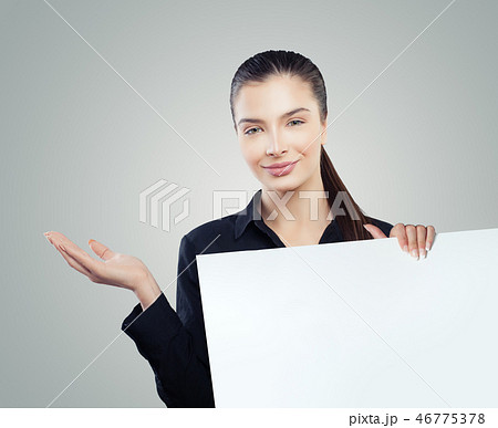 Cute business woman with empty open hand 46775378