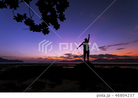 man tourist standing on the stone in tropical sea 46804237