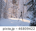 DSLR camera with tripod in snowy landscape 46809422