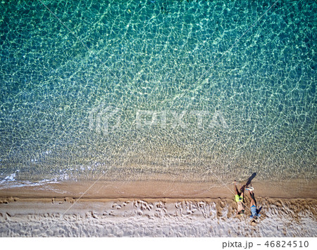 Beautiful beach with family drone shot 46824510
