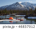 Couple man and woman in a camp at mountain terrain. Lake shore with canoe 46837012