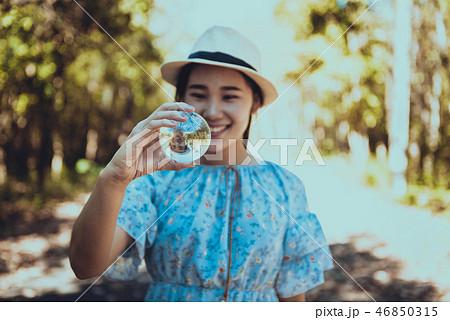 Beautiful woman hold crystal ball 46850315