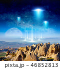 Aliens spaceship fly above surreal terrain 46852813