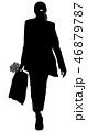 Silhouette of a girl with a bag in her hands 46879787