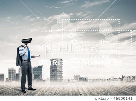 Camera headed man standing on wooden floor against modern citysc 46900141