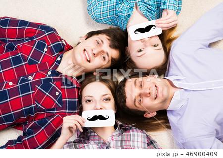 four young men lie together 46900409