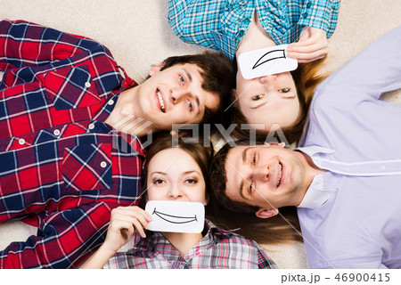 four young men lie together 46900415