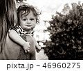 mother with a child on little greek village street 46960275