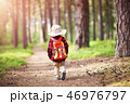 boy going camping with backpack in nature 46976797