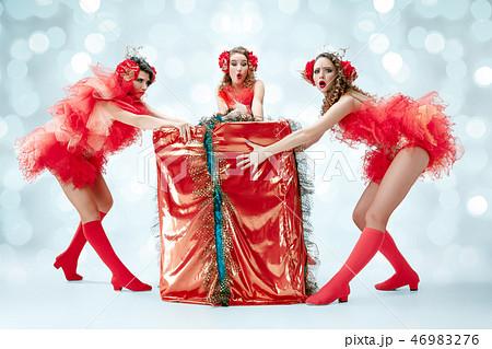 young beautiful dancers posing on studio background 46983276