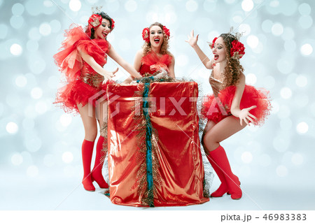 young beautiful dancers posing on studio background 46983383