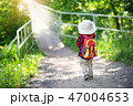 boy going camping with backpack in nature 47004653