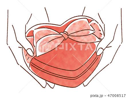 バレンタインデー チョコレートを渡す女性の手 47008517