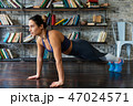 Woman doing push ups workout during fitness training on floor at home 47024571