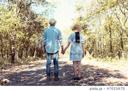 Young couple holding hands  47033670