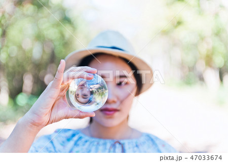 Beautiful woman hold crystal ball and can see  47033674