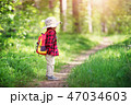 boy going camping with backpack in nature 47034603
