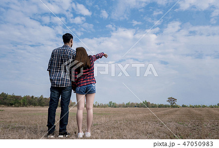 Young couple in love in the meadow 47050983