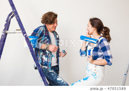 People, renovation and repair concept - Portrait of lovely couple doing redecoration in apartment 47051589