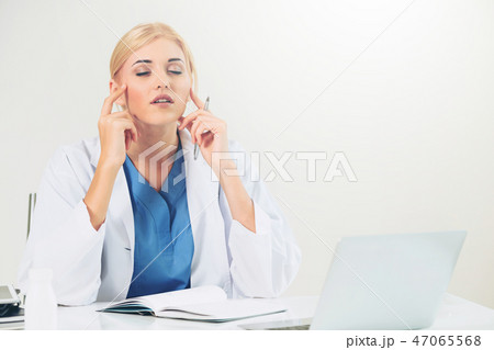 Doctor in hospital working on medical report. 47065568
