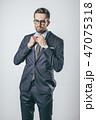 Elegant businessman tying necktie 47075318