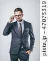 Confident businessman adjusting glasses 47075319